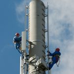 Telecom technicians at work on an LTE base station